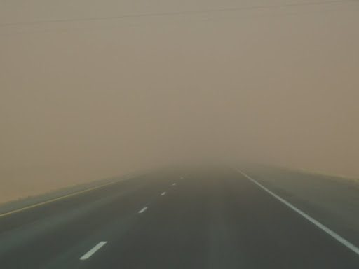 Highway leading into a dust storm