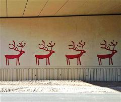 Four red deer on the wall under the new traffic interchange on I-17 at Munds Park.