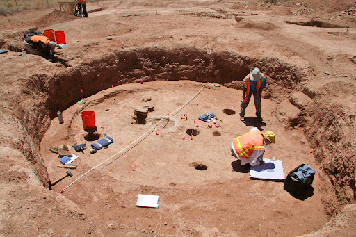 ADOT Historic Preservation Team work taking measurements and making notes as they work an archaeological site near SR 77