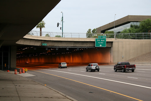 Cars entering the Papago Freeway tunnel, better known as the Deck Park Tunnel