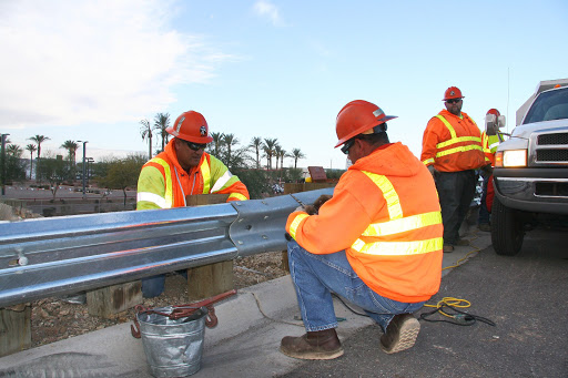 ADOT workers repairing a guardrail