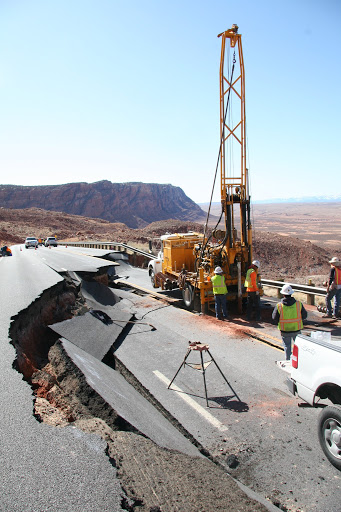 ADOT workers clearing and repairing broken road from a landslide