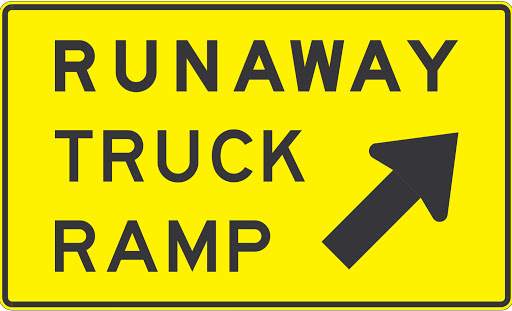 Runaway Truck Ramp sign with arrow pointing up to the right