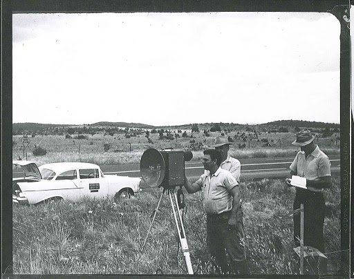 Three men are using a microwave distance measuring unit