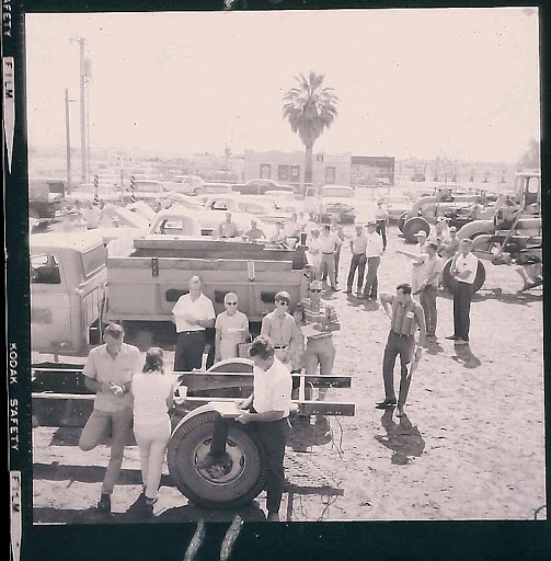 Crowds of people looking at vehicles up for auction