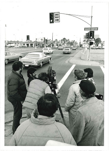 Black and White photo of video being taken in the intersection of Van Buren Street and the Black Canyon Freeway