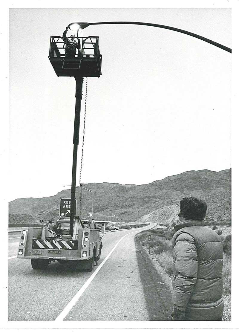 Worker fixing a streetlight in 1978