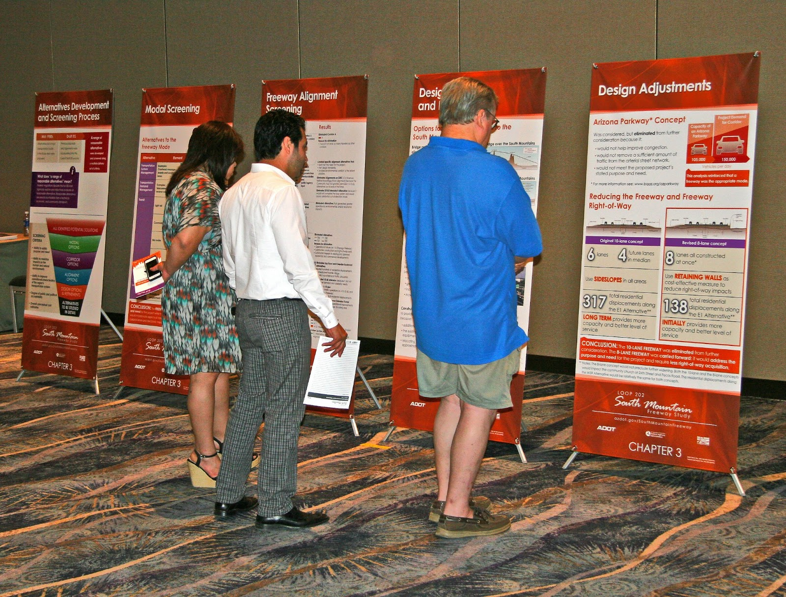 Citizens check out South Mountain Freeway display boards