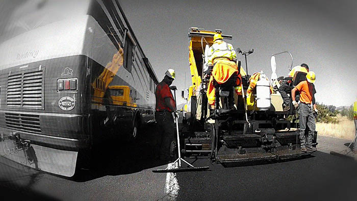 ADOT crew smooths new asphalt.
