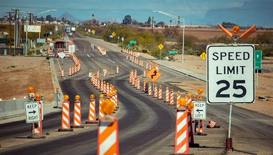 Work zone with traffic cones, speed limit and curve sign