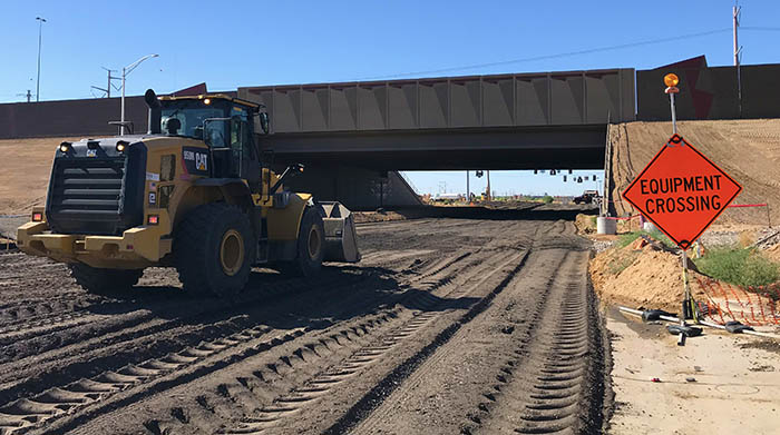 Front end loader travels towards future 40th Street intersection overpass.