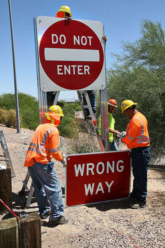 ADOT workers putting up wrong way road signs