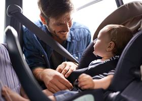 Buckling child into a car seat