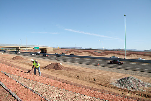 Crews work on the large landform graphics along I-17.