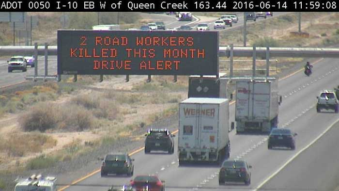 """Highway Sign: """"2 road workers killed this month - drive alert"""""""