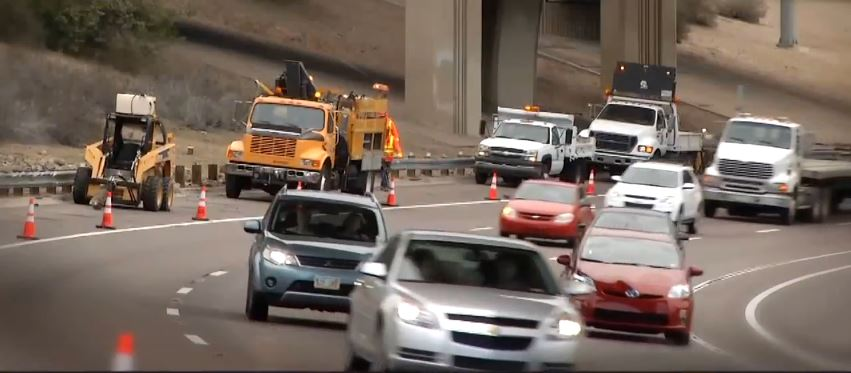 Traffic on the I-10 moves over for work crew