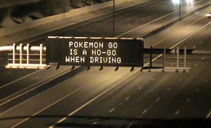 Highway Sign: Pokemon Go is a No-Go when Driving.