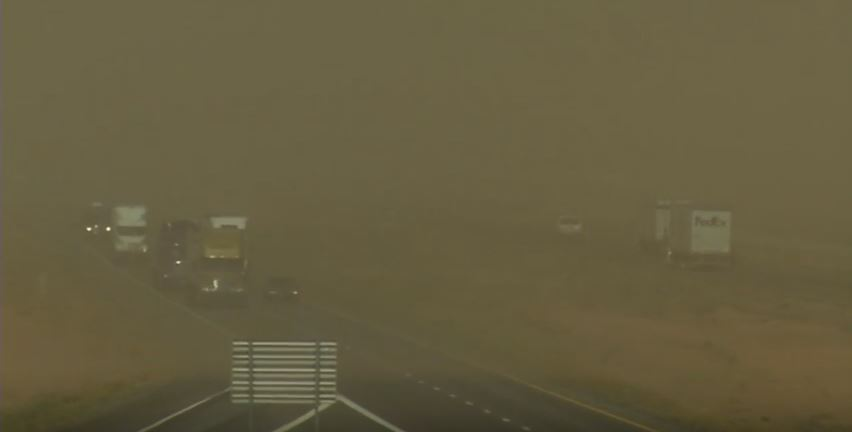 Dust storm reduces visible for traffic on the highway