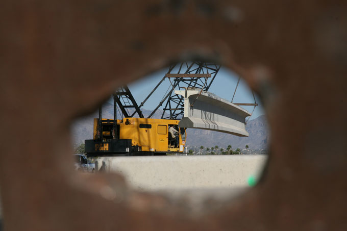 View through a hole of a girder being placed