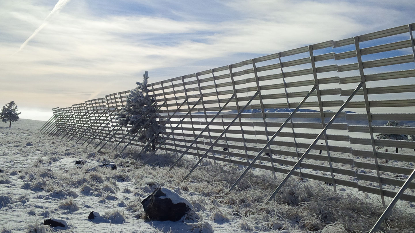 Snow fences are designed to prevent snow from drifting across the highway.