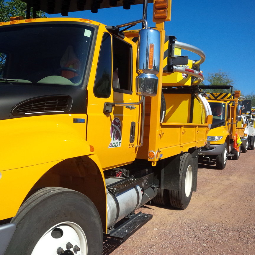 Attenuators and cone trucks staged for emergency.