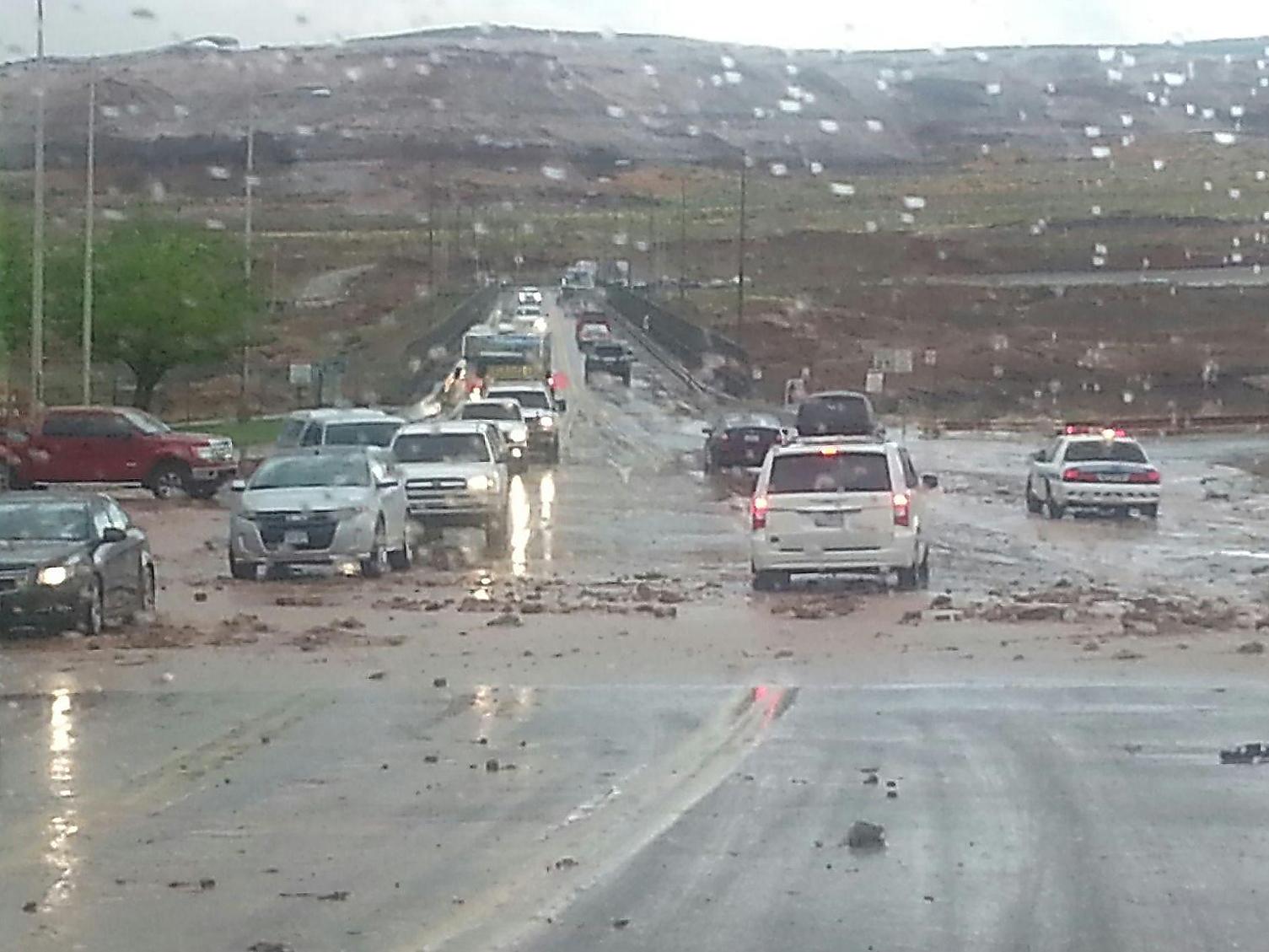Heavy rain, mudflow and large rocks slow traffic on US 89.