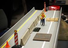 A model display highlights a bridge repair innovation.