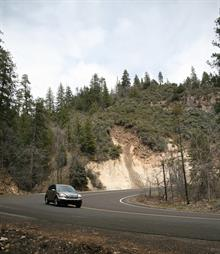 Car travels along a curving mountain road
