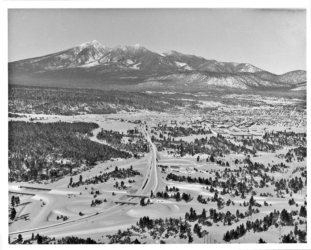 1967 Aerial photograph of Flagstaff covered in snow