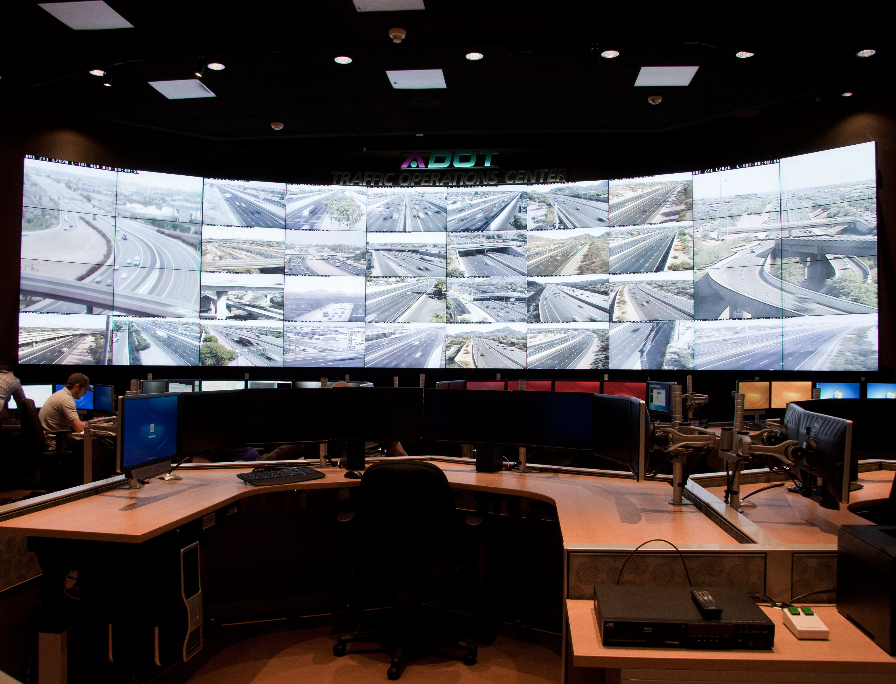 Forty monitors line the wall of ADOT's Traffic Operations Center.
