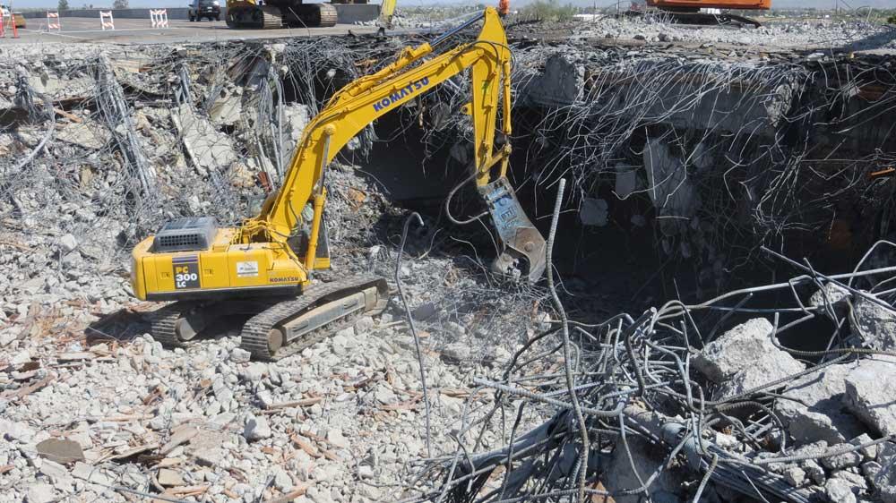 Heavy equipment dismantling I-10 bridge over Perryville Road.