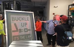 """Buckle Up It's the Law"" Sign Screen"