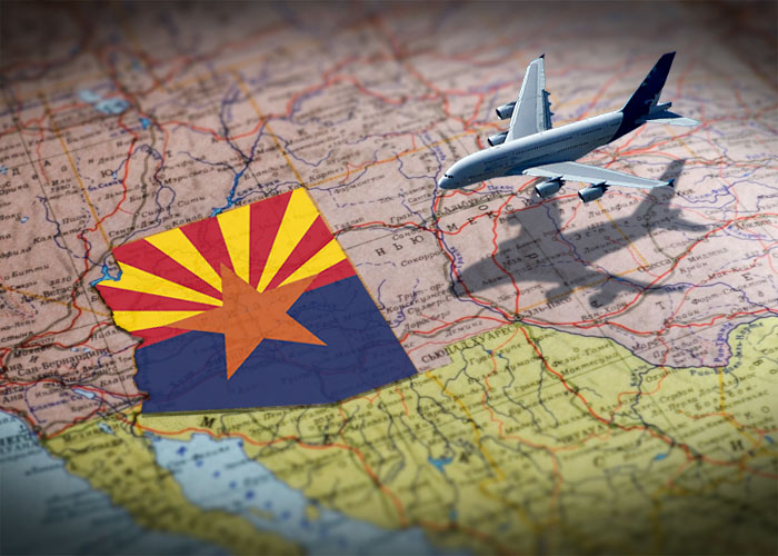 Jet liner flying over map of the southwestern US toward Arizona shown as state flag.
