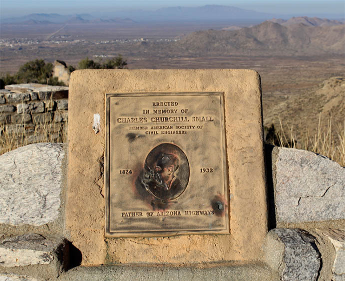 "A weathered bronze plaque on a highway marker honors C.C. Small as the ""Father of Arizona Highways."
