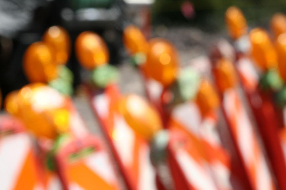 An Impressionist view of the familiar orange traffic barricade.