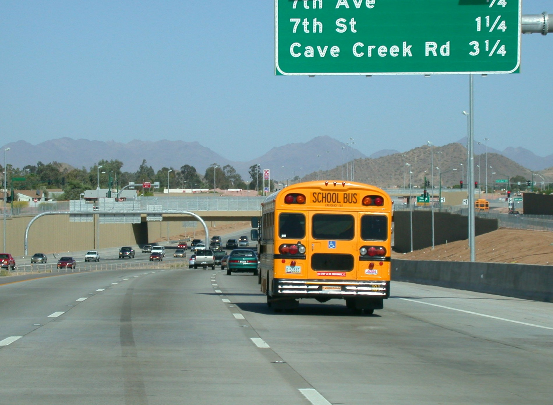 School bus traveling on a freeway