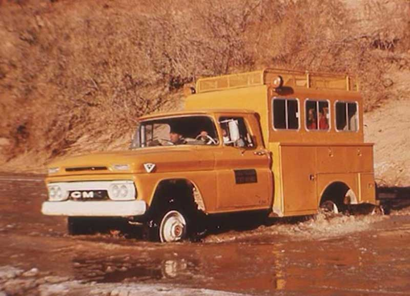 Truck in the 1970s driving across a river