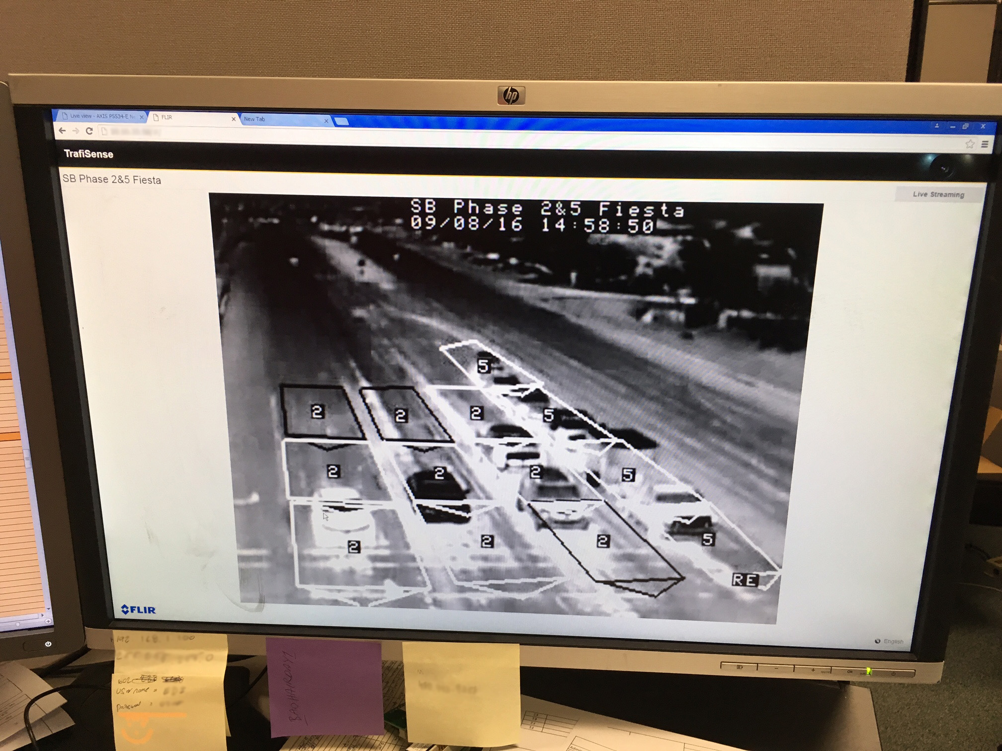 Monitor showing heat camera image of traffic