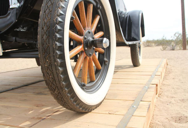 Close up of narrow wheels of early car.