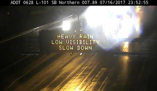 Dynamic Message Sign: Heavy rain low visibility slow down