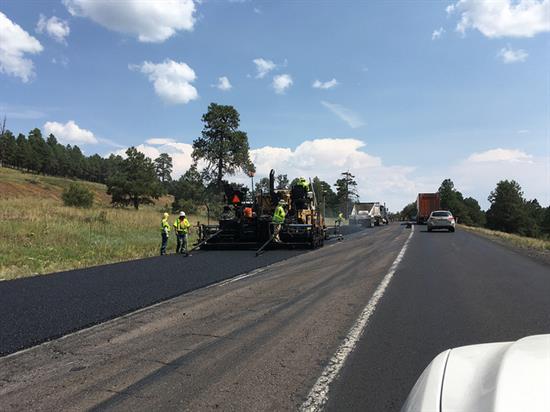 Road crew repairs pavement