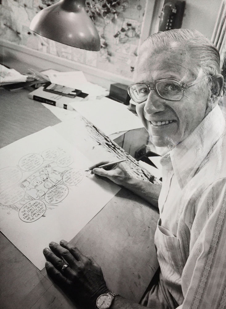 Famed cartoonist Bil Keane creating a special transportation related Family Circus cartoon