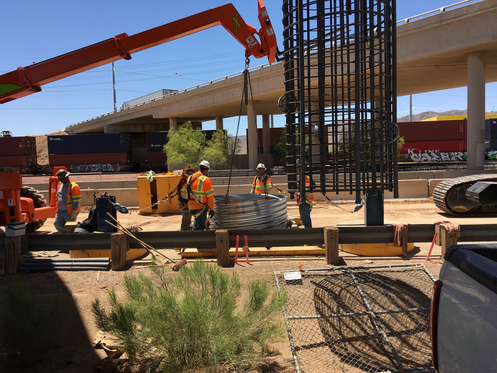 Crews working along Jimmie Kerr Boulevard under the bridges that carry Interstate 10 traffic
