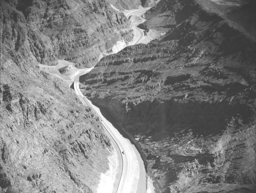 Historic photo looking down on I-15 as it snakes through canyons.