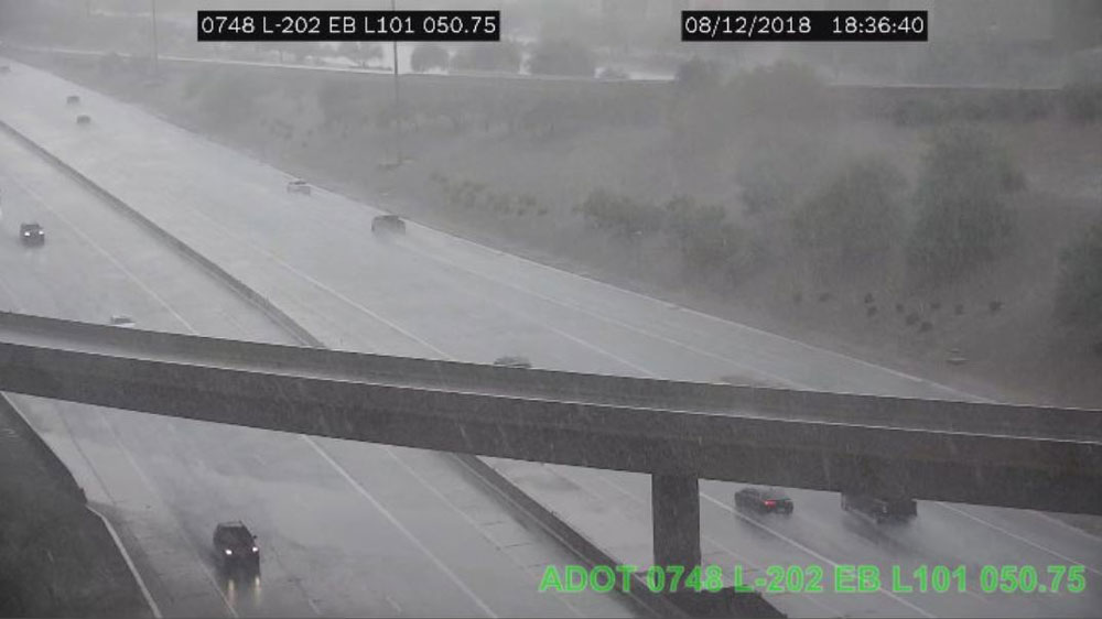 Traffic camera view of monsoon rains on the freeway.