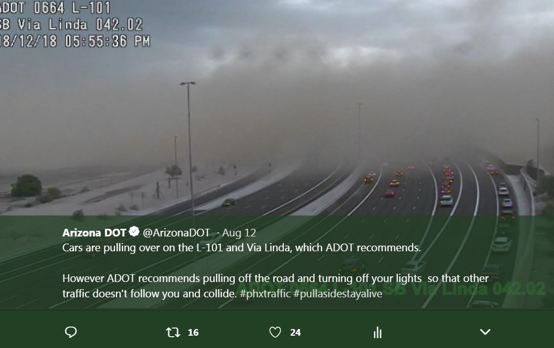 Traffic camera view of dust storm blowing across the freeway.