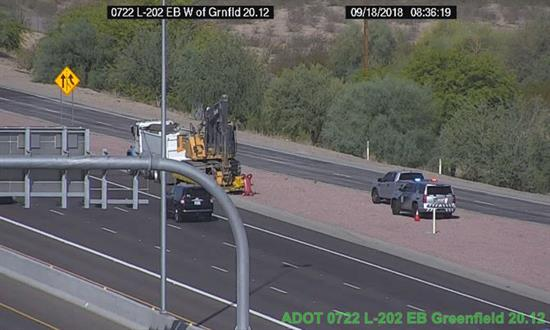 Construction equipment involved in strikes to the I-17 bridges is visible on the traffic camera.