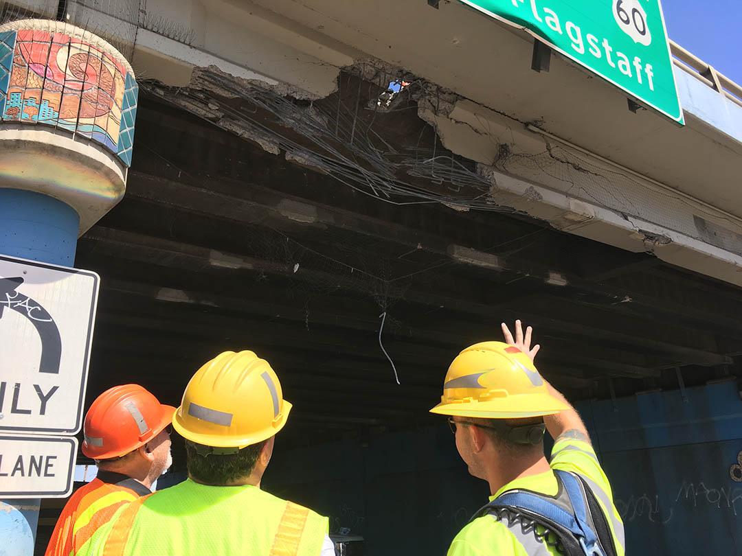 ADOT crew exam damage to I-17 bridge caused by construction equipment.
