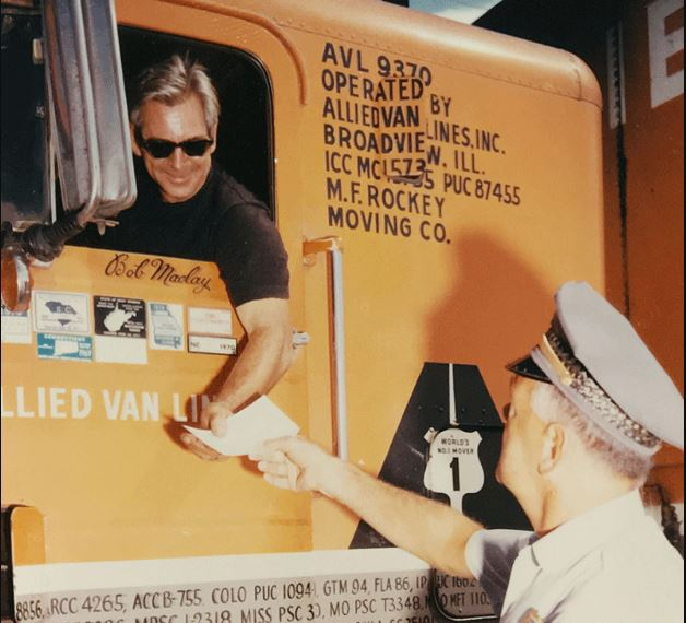 Vintage photo of a truck driver and commercial vehicle inspector.