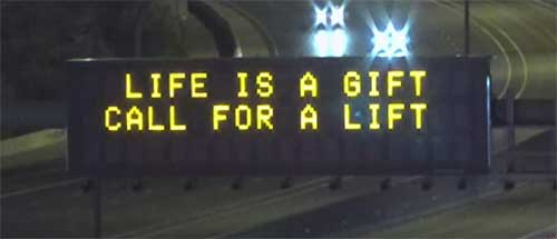 "Dynamic Message Sign - ""Life is a gift / Call for a lift"""